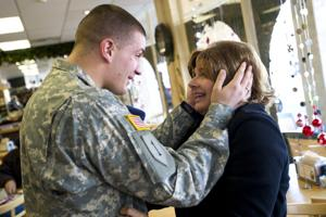 Tears flow as soldier, mom reunite