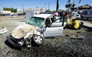Car hits train in Downtown Lodi, seriously injures child