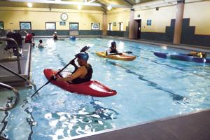 Kayakers practice moves at Hutchins pool
