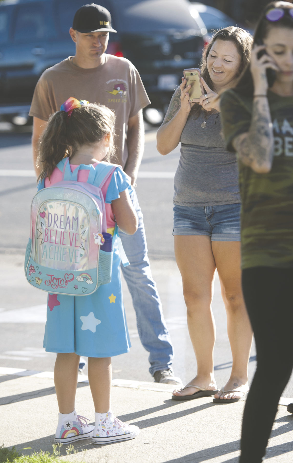 Arriving with class: Eager children excited to start new school year