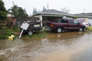 Truck collides with fire hydrant, car