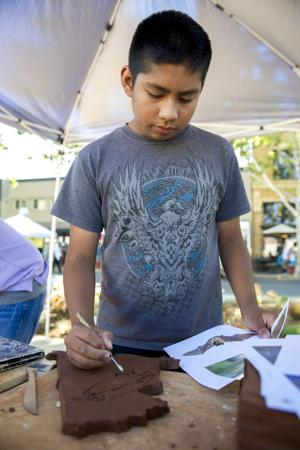 Lodi residents turn out to create tiles for Downtown bench