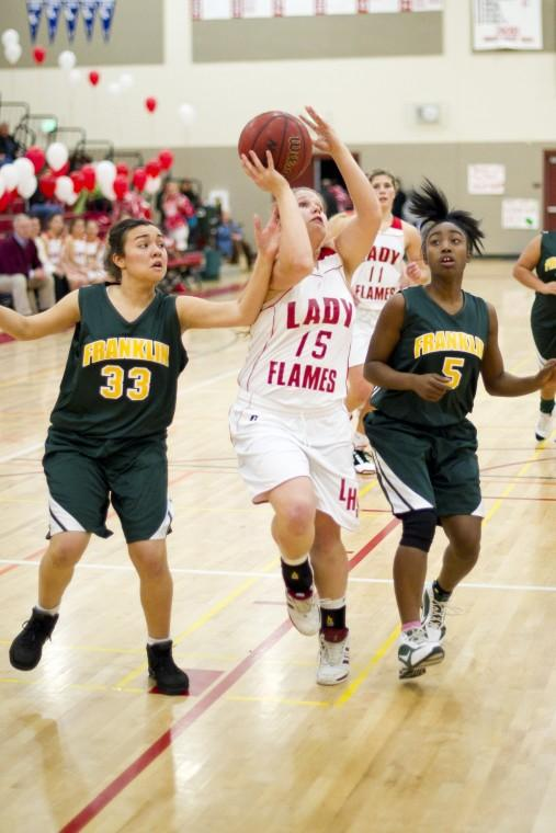 Lodi Flames take care of business in varsity girls basketball