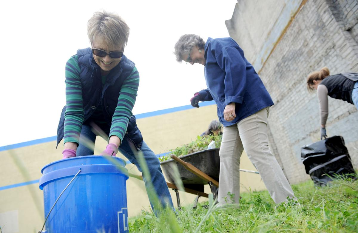 Volunteers spend time beautifying lot