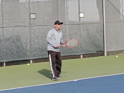 Woodbridge club hires tennis pros, resurfaces courts