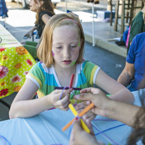 Little Buckaroos Saddle Up To Read At The Reading Roundup : Elise Selling, 10, makes popsicle stick crafts during the second annual Little Buckaroos Reading Roundup Literacy Fair, hosted by the Lodi News-Sentinel and the Lodi Public Library, on Locust Street in Downtown Lodi on Saturday, Aug. 24, 2013. - Ian Jonsson/News-Sentinel