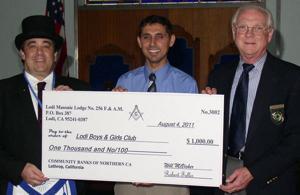Lodi Masonic Lodge presents check for $1,000 to Lodi Boys and Girls Club