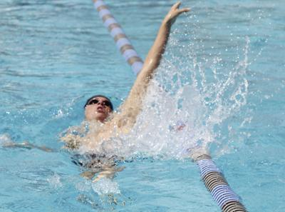 High school swimming: Flames finish strong at TCAL