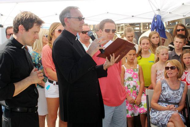 St. Anne's Catholic Church priests bless grapes in memory of John Van Ruiten Sr.