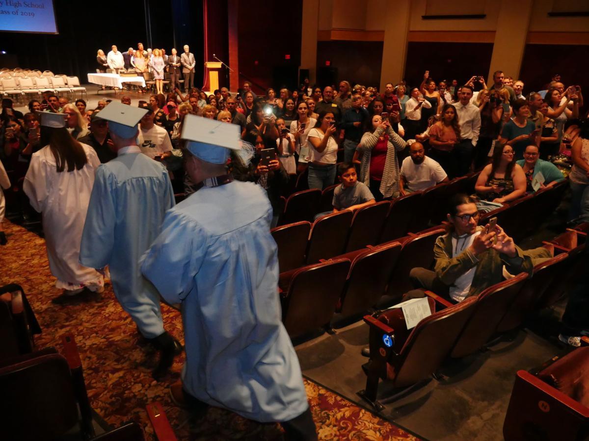 Liberty High graduates handle adversity like 'champions'