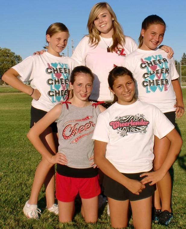 Tori Lauchland helps coach junior cheerleaders