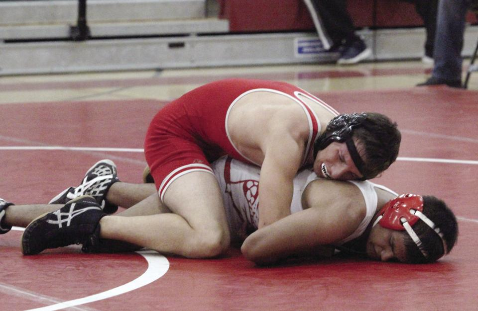 Wrestling: Flames control 'Dogs in thrilling match