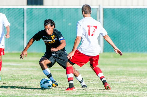 Boys soccer: Flames defend their turf against Tigers