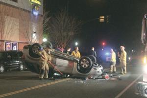 Woman injured after rollover crash on Church Street