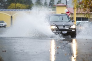 Storm Swamps Lodi: A vehicle creates waves as the driver steers through a deep puddle on Hutchins Street in Lodi on Friday, Nov. 30, 2012.  - Dan Evans/News-Sentinel