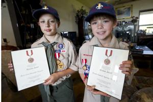 Twin Boy Scouts honored for saving father's life during heart attack