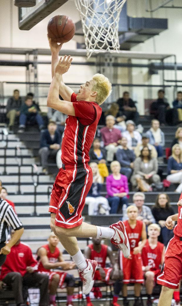 Boys basketball: Flames denied at buzzer, lose to Titans