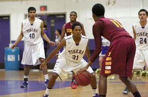 Boys basketball: Tigers tower over Vikings