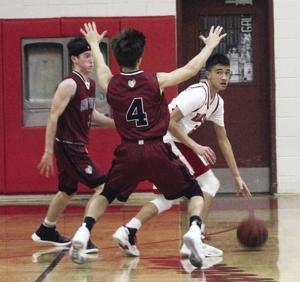 Boys basketball: Warriors sink free throws to beat Rams