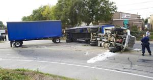 Highway 99 ramp closed after big rig carrying tomato sauce flips over
