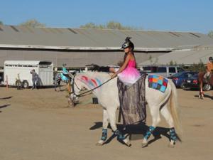 Liberty Oaks Pony club members dress up for Halloween parade