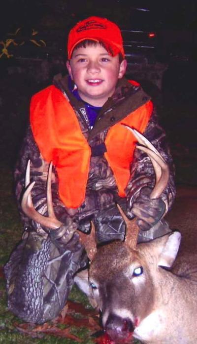 9-year-old bags deer