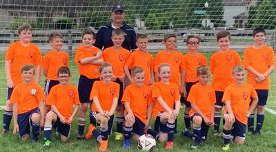 11-under soccer tourney champs