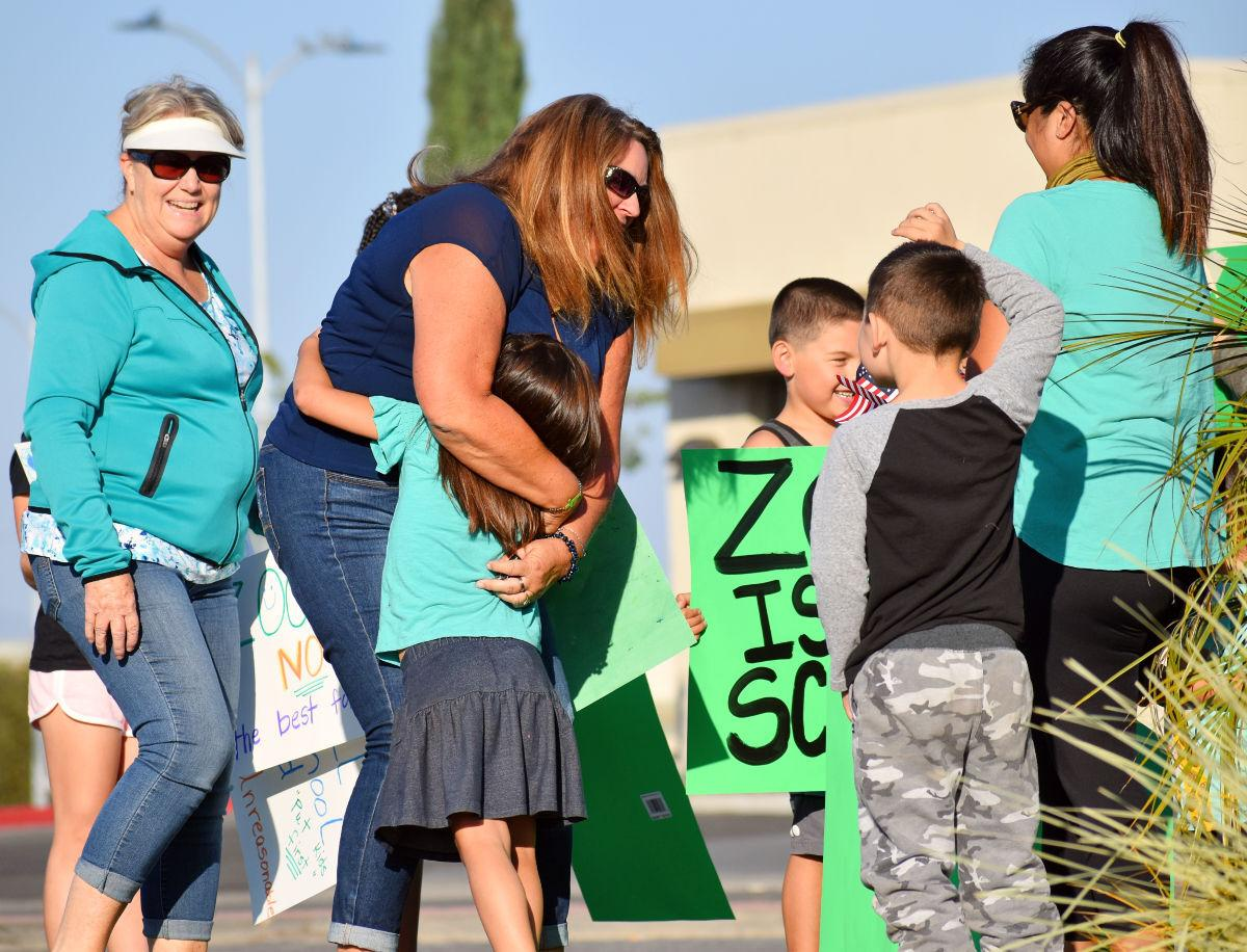 Ralph Dunlap Elementary School Kindergarden teacher Shannon Day greets her students