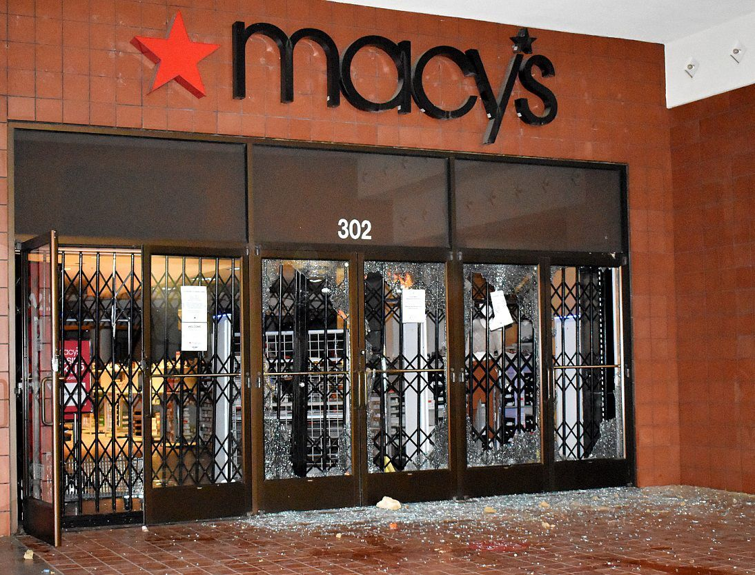 Doors of Macy's department store was vandalized during a protest in Santa Maria Sunday night.