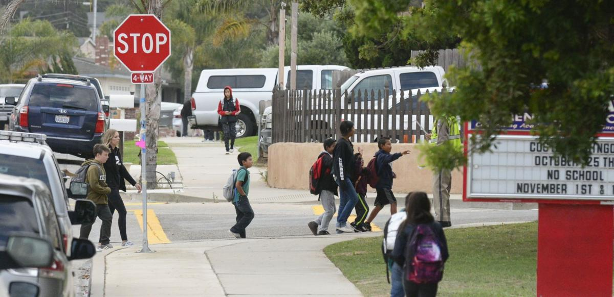 Students walk to Alice Shaw Elementary School in October 2018
