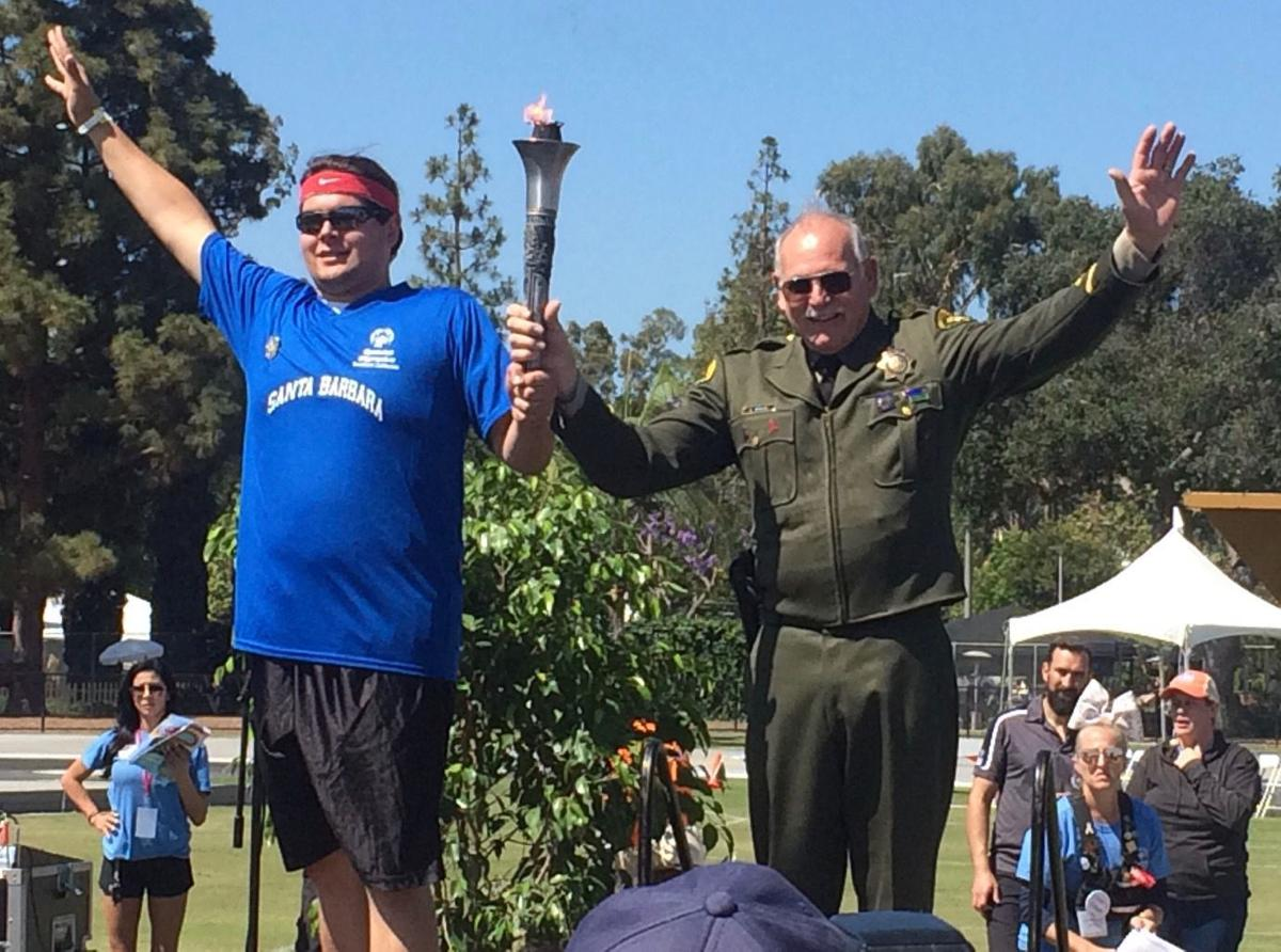 Sherriff's lieutenant carries torch into Special Olympics Summer Games
