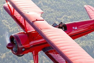 Champion air racer Vicky Benzing showcasing graceful power of 1940s Stearman at AirFest