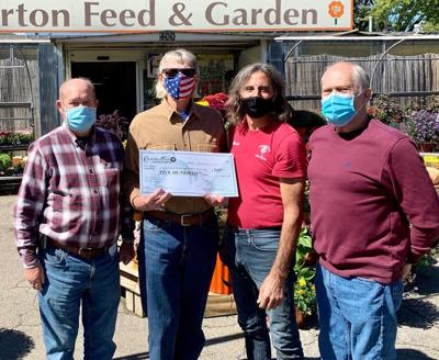 Chesterton Feed & Garden donates to bird sanctuary