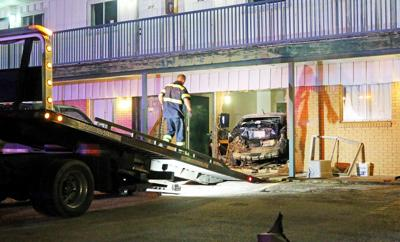 No injuries reported after man allegedly rams truck into back of car, forcing car into room at Petty's Motel