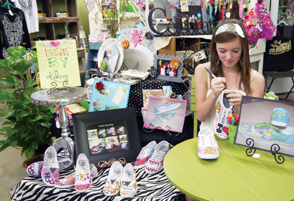 Kelsey Howard works on a pair of shoes