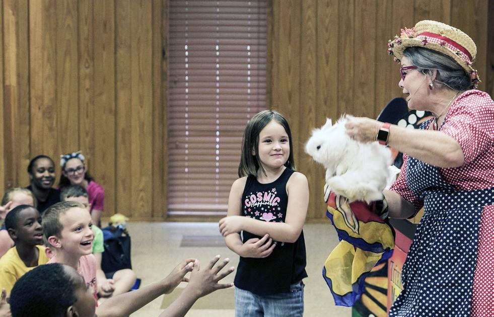 Magician Trixie Bond charms audience at T.L.L. Temple Memorial Library