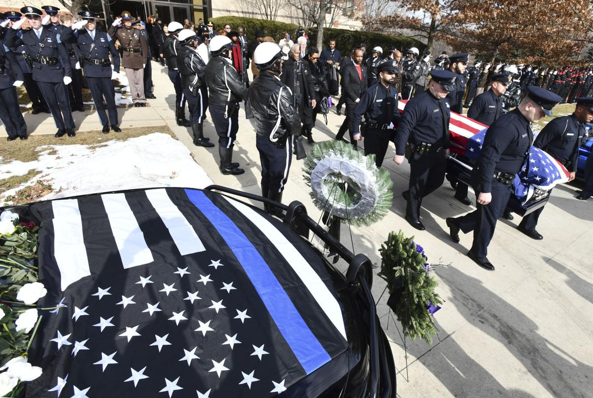 Funeral held for slain Detroit officer and Utica HS grad Doss
