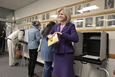 Mary Burke casts an early ballot
