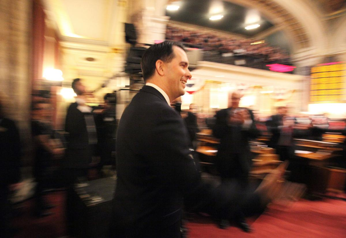 Gov. Scott Walker enters the Assembly chambers to deliver his sixth State of the State