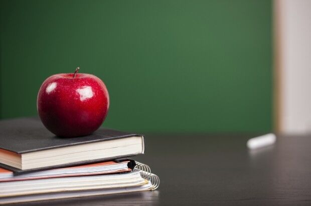 School book and apple, generic file photo