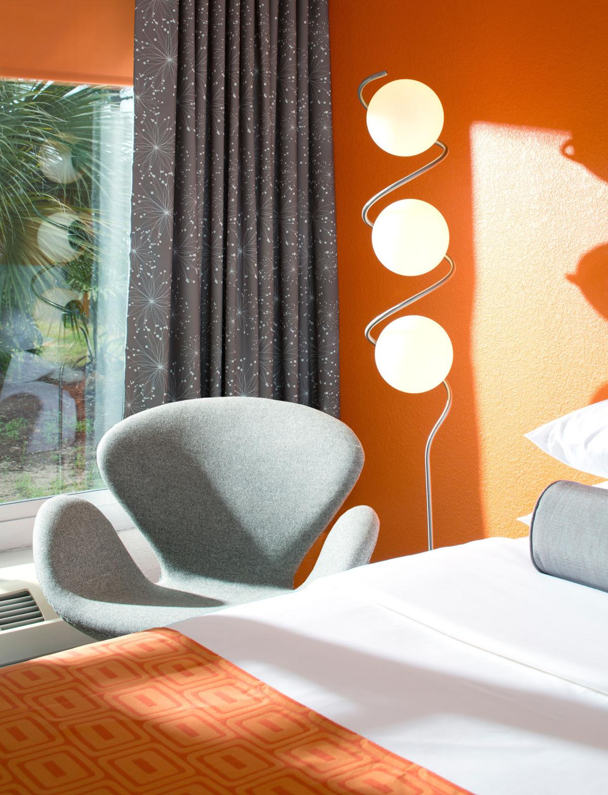 The room's desk areas reflect a contemporary take on the midcentury look at a Howard Johnson hotel in Orlando, FL.