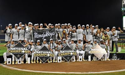 Players and coaches of the Vanderbilt Commodores celebrate after defeating the Michigan Wolverines to win the National Championship at the College World Series on June 26, 2019 at TD Ameritrade Park Omaha in Omaha, Neb.