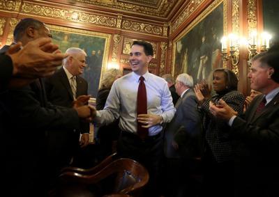 Scott Walker with cabinet extraordinary bills
