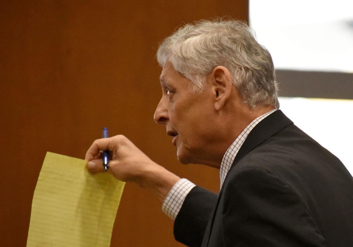 Benavides holds up sheet of paper