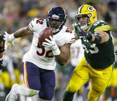 Khalil Mack pick-6, AP photo