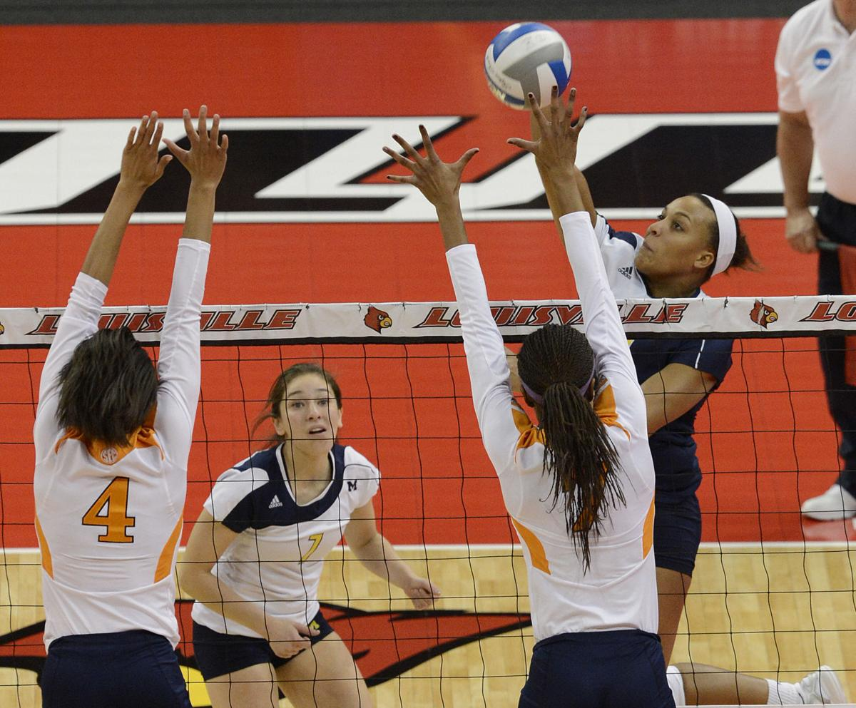 Molly Toon volleyball for Michigan 2012, AP photo