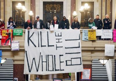 kill the bill recall protest sign Feb 2011 file photo