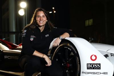 Simona De Silvestro, test and development driver for the TAG Heuer Porsche Formula E Team, pictured with the Porsche 9 XX Electric Formula E car on the occasion of the presentation of the new Porsche Taycan, at Dock 10 Studios on January 23, 2020 in Manchester, England.