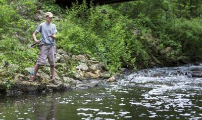 Jacob Gillitzer fishes in Pheasant Branch Creek