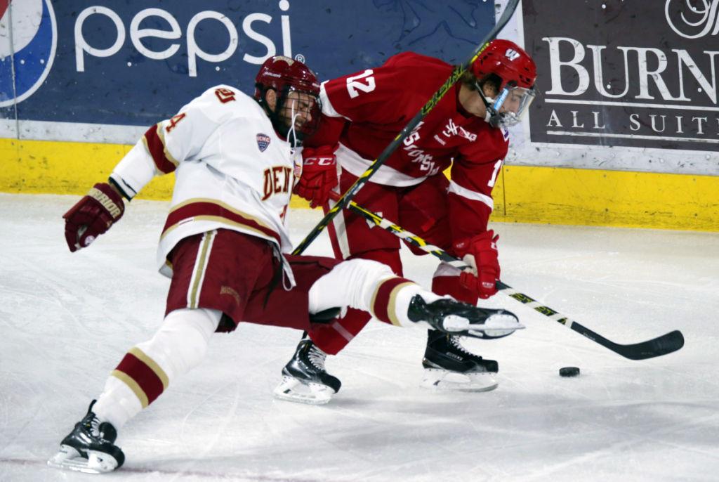 Grant Besse, UW hockey, AP photo